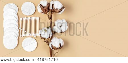 A Branch Of Cotton, Cotton Wool And Cotton Buds On A Beige Background. Natural Cotton Products. Conc