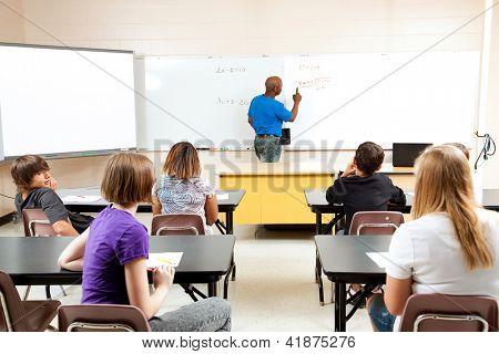 African-american male teacher teaches a diverse high school math class.