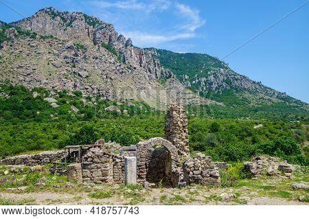 Remains Of Medieval Fortress Funa & Valley Of Ghosts On Background. Ruins On Foreground Is Church Of