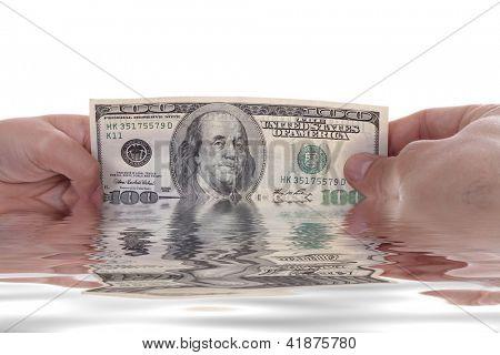 mano sosteniendo un billete de un dólar, Foto de estudio de negocios
