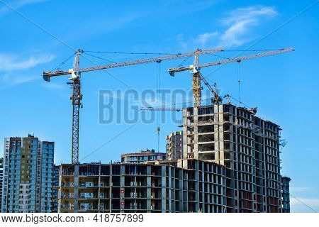 New High Rise Buildings Under Construction & Tower Cranes With Its Arrows. Finished Buildings Are On