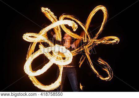 Sexy Woman Performer Create Beautiful Fire Patterns Dark Outdoors, Firedancer