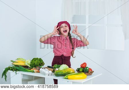 Deserve Well. Child Show Ok Gesture. Cook With Vegetables At Kitchen. Natural Useful Food.
