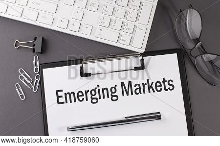 Office Paper Sheet With Text Emerging Markets With Office Tols And Keyboard. Business