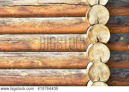Texture Of Wall Of House Made Of Rounded Logs. Facade Of Log House, Space For Text. Wooden Log Wall