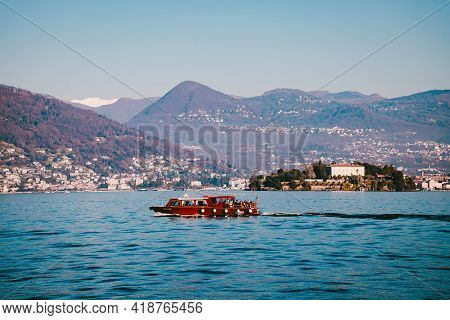 Lake Maggiore, Italy - December 2020: Tourist Boat Browsing With Tourists On Board On Lake Maggiore