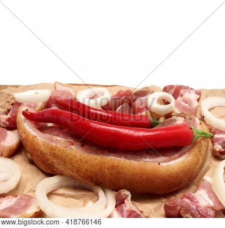 Bacon with onions and spices on the board. Raw bacon