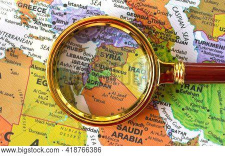 Lviv Ukraine-02 09 2021 :syria, Jordan, Israel, Lebanon A Map Of Asia In A Defocused Magnifying Glas
