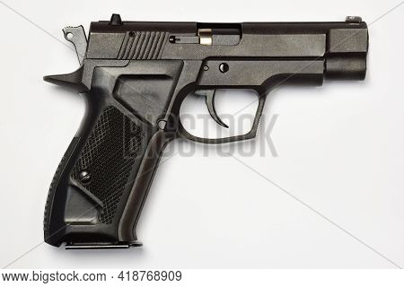 Black Combat Pistol On A White Clipping Background. Side View Close Up