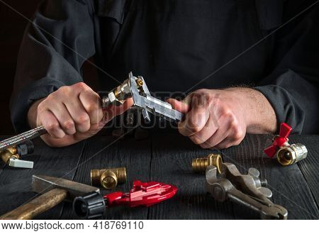Wizard Or Master Measures The Size Of Fitting Using A Caliper Before Connecting Water Or Gas Pipe. C
