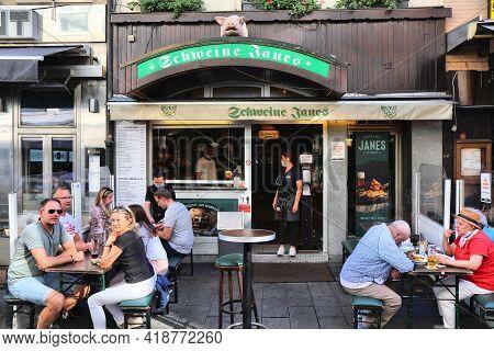 Dusseldorf, Germany - September 19, 2020: People Visit German Restaurant Pub Schweine Janes In Downt