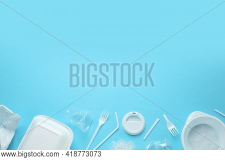 Plastic Dishware On Light Blue Background, Flat Lay. Space For Text