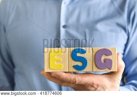 Wooden Blocks With Abbreviation Esg In Hands.