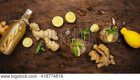 Ginger Ale Cocktail With Beer, Lime, Lemon And Mint In Glaass On Wooden Table, Top View Banner
