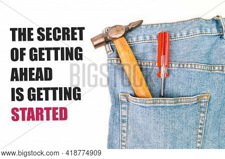 Phrase The Secret Of Getting Ahead Is Getting Started Written Over White Background With Hammer, Scr