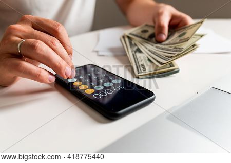 Accounting, Taxes And Finances Concept. Man With Papers And Calculator Counting Money At Home, The C