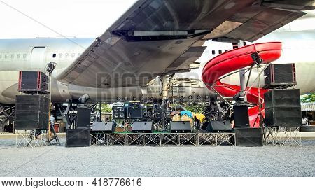 Bangkok, Thailand - July 15, 2017 : Musical Instrument On Stage Under A Large Plane And A Red Slider