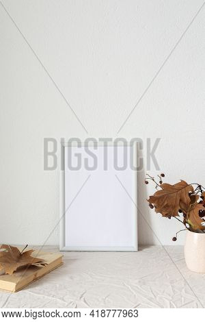 Home Decor Mocap, Empty Picture Frame Near White Painted Concrete Wall, Branches With Dry Leaves In