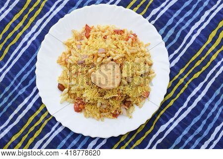 Bhelpuri, Indian Popular Street Food Made From Puffed Rice And Sev. Indian Teatime Snacks Served In