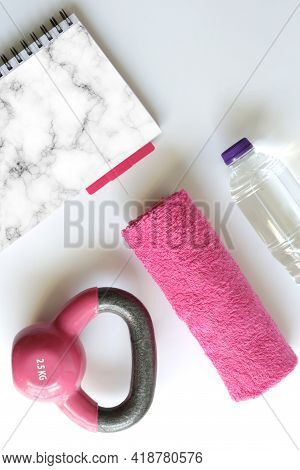 Sport Feminine Accessories, Flat Lay, Pink Dumbbell Pink Notepad For Mock Up, Copy Space. Gym Access