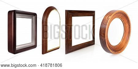 Set Of Wooden Frames For Paintings, Mirrors Or Photo In Perspective View Isolated On White Backgroun