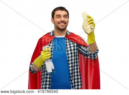 cleaning and people concept - happy smiling man in superhero cape and rubber gloves with rag and detergent over white background