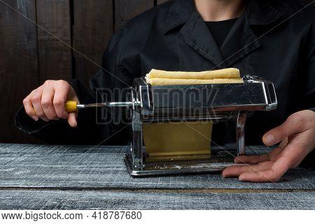 The Process Of Preparing Fresh Pasta. Chef Preparing Pasta Dough On A Typewriter, Copy Space