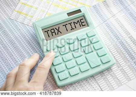 Tax Time Word On Calculator. Business And Tax Concept. Time To Pay Tax In Year.