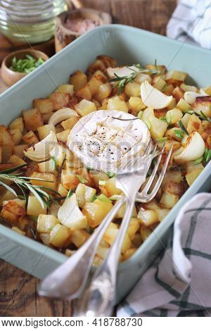 Fried Potato Cubes With Camembert Cheese, Rosemary And Green Onion Dressing In Ceramic Cookware