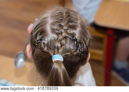 Close-up Of A Hairstyle With Pigtails And An Elastic Band On The Girls Head. Hair Styling Is Done Wi