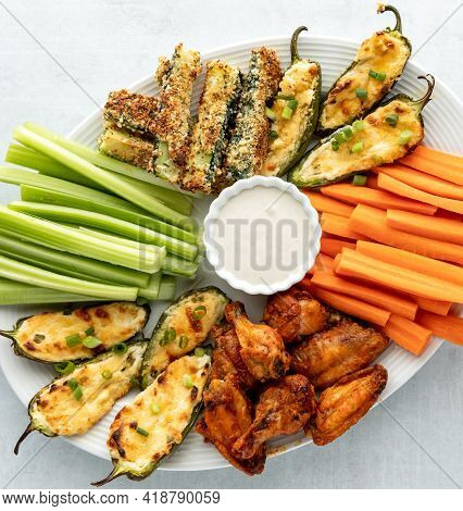 Top Down Close Up View Of A Finger Food Appetizer Platter Including Wings, Jalapeno Poppers And Zucc