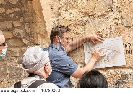 Jerusalem, Israel, March 3, 2021 : The Licensed Guide Talks And Shows To The Group While Standing Ne