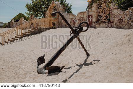 Berdyansk, Ukraine - 06.08.2020: Hige Metal Old Anchor Monument At The Sand Beach Of Ukrainian Azov
