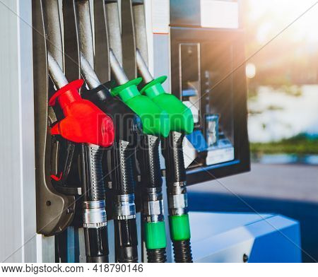 Colorful Fuel Pumps At Petrol Gas Station