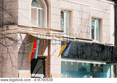 Azerbaijani And Ukrainian Flags Hangs On The Facade Of Old Building. Embassy. Relationship. Friendsh