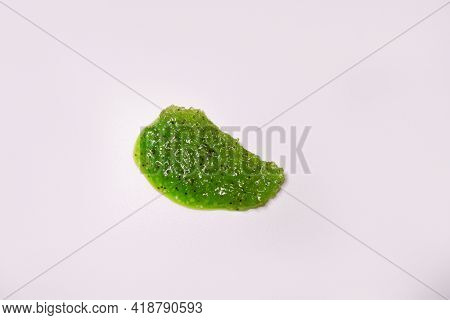 Skin Scrub Smear On White Background. Cosmetic Anti-cellulite Product With Green Clay, Cane Sugar, E