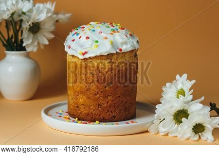 Easter Cake And Flowers On Orange Pastel Easter Background