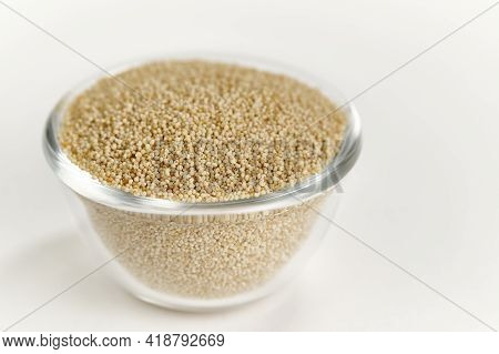 White Poppy Seeds In A Glass Bowl On A White Background