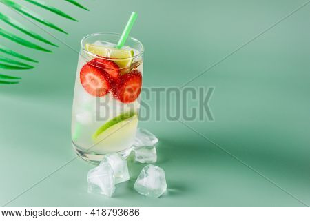 Glass Of Tasty And Cold Strawberry And Lime Lemonade Summer Cold Drink Green Background Copy Space
