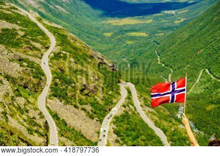 Norwegian Flag And Trolls Path Trollstigen Winding Scenic Mountain Road In Norway Europe. National T