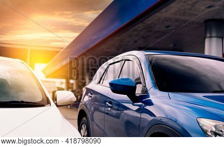 Blue Suv Car With Sport Design Parked At Gas Station. Blue Car On Blur Strong Concrete Bridge. Gas S