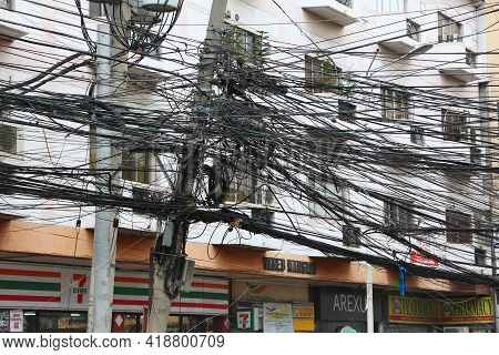 Manila, Philippines - November 24, 2017: Tangled Cables And Chaotic Wires In Manila, Philippines. Me