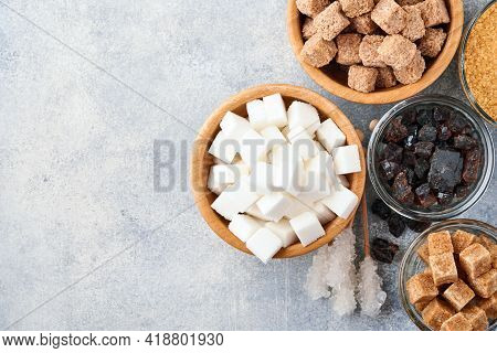White Sugar, Cane Sugar Cubes, Caramel In Bamboo Bowl On Gray Table Concrete Background. Assorted Di