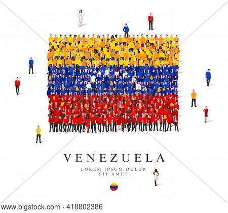 A Large Group Of People Are Standing In Yellow, Blue, White And Red Robes, Symbolizing The Flag Of V