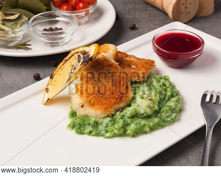 Breaded Fish Fillet With Spinach Puree Garnish