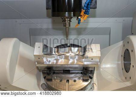 The Hi-precision 5-axis Machining Center Cutting The Shoe Mold Parts. Hi-technology  Mold And Die Ma