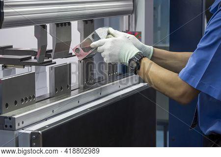The Technician Operator Working With Hydraulic Press Brake Bending Machine. The Sheet Metal Working