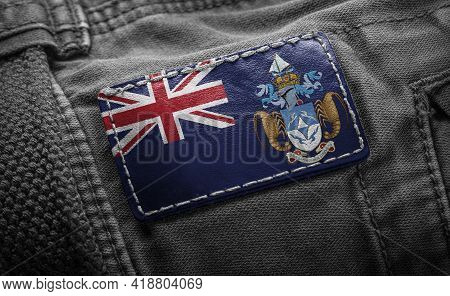 Tag On Dark Clothing In The Form Of The Flag Of The Tristan Da Cunha
