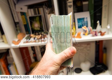 Male Hand Holding Large Stack Of Thousands Of Euros 100 And 500 Euro Bills