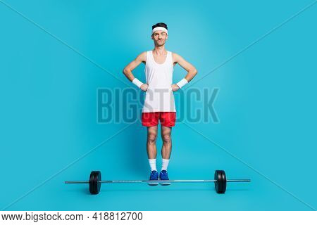 Full Body Photo Of Young Sportsman Confused Hesitate Barbell Workout Gym Isolated Over Blue Color Ba